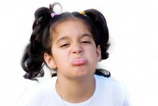 Free Girl Sticking Out Her Tongue Royalty Free Stock Images - 9910079