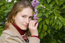 Free Woman And Lilac Royalty Free Stock Image - 9910666