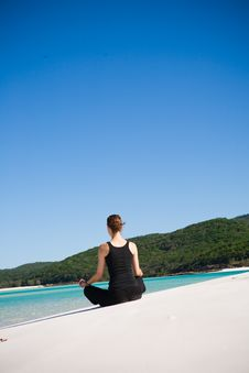 Free Woman Meditating On Beach Stock Photo - 9911210