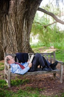 Free Relaxing On Park Bench Royalty Free Stock Image - 9911316