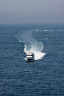 Boat Leaving Sea-foam Trace Stock Photo