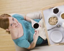 Free Cute Redhead With Breakfast Tray Stock Photo - 9913220