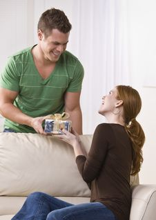 Free Man Giving Gift To A Woman. Royalty Free Stock Photo - 9913395