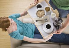 Free Woman Being Served Breakfast On The Couch. Royalty Free Stock Image - 9913646