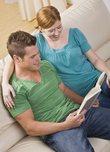 Attractive Couple Reading Together Stock Photos