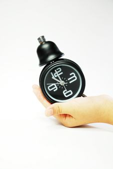 Free Hand With Black Alarm Clock Royalty Free Stock Images - 9914289