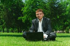 Free Businessman In The Park On Grass Royalty Free Stock Images - 9915519