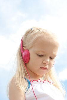 Free Little Blonde Girl With Red Earphones Royalty Free Stock Images - 9917439