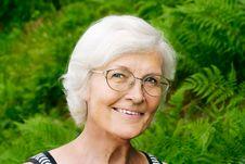 Senior Woman  On Fern Background Stock Photo