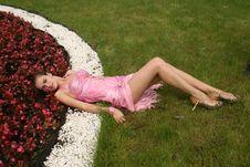 Girl Lying Among Flowers Royalty Free Stock Photos