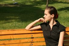 Free Girl Sitting On Bench Royalty Free Stock Photo - 9919165