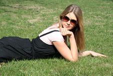 Girl Resting On Grass Stock Image