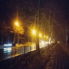 Free Night Street Next To Pedestrian Pathway  Royalty Free Stock Photos - 99110108