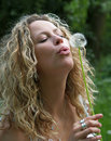 Free Curly Girl Blows Dandelion Royalty Free Stock Photo - 9921475