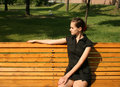 Free Pretty Girl Sitting On Bench Stock Photography - 9926842