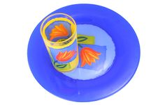 Plate And Glass Of Dark Blue And Yellow Colour Stock Images