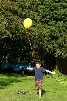 Boy Playing With Balloon Royalty Free Stock Image