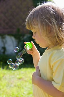 Free Boy Blowing Bubbles Stock Photography - 9926362