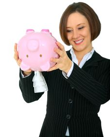 Happy Woman Taking Money Out Of Piggy Bank Stock Photography