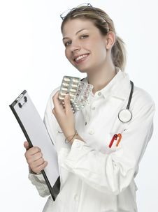 Free Female Doctor Handing Medicine Stock Images - 9926804