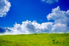 Free Green Grassland And Clouds Royalty Free Stock Images - 9927019
