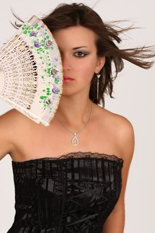 Girl With Fan Over Her Face Stock Photo
