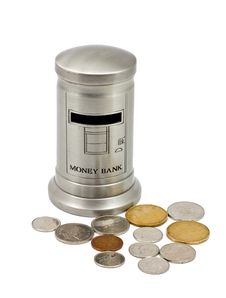 Money Bank With Coins Stock Photography