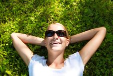 Free Beautiful Girl Lying Down Of Grass Royalty Free Stock Photo - 9930365