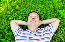 Free Young Man Lying On The Grass Stock Images - 9930374