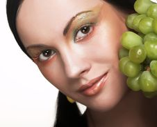 Woman With Green Grape Stock Image