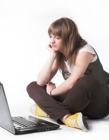 Free Casual Teenage Girl On A Laptop Royalty Free Stock Image - 9933026