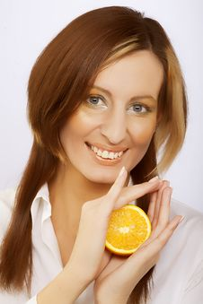Cheerful Woman With Fresh Orange Near Her Face Royalty Free Stock Photo