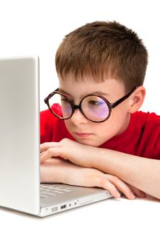Free Boy With A Laptop Royalty Free Stock Image - 9934166