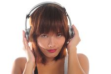Free Young Asian Woman Listening Music Royalty Free Stock Photography - 9936147