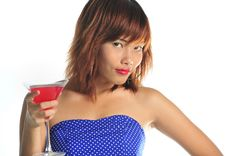 Free Young Asian Woman Holding A Glass Of Cocktail Stock Photography - 9936232