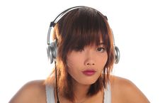 Free Young Asian Woman Listening Music Stock Photo - 9936250