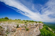 Free Mountain Cliff With Green Plants Royalty Free Stock Image - 9937606