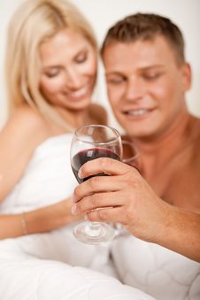 Young Couple Toasting Champagne Stock Photo