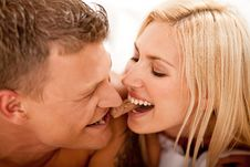 Young Couple Sharing Stock Photography