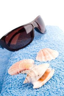 Towel, Shells, Sunglasses Stock Images