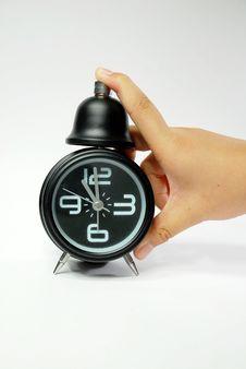 Free Hand With Black Alarm Clock Stock Image - 9947481