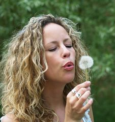 Free Curly Girl Blows Dandelion Royalty Free Stock Photos - 9947558