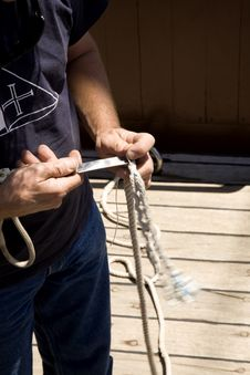 Free Sailor Cutting Cables In A Ship S Deck Royalty Free Stock Photos - 9948598