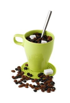 Mug With Coffee Beans Stock Photos