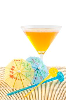 Orange Cocktail On Bamboo Placemat Royalty Free Stock Photography