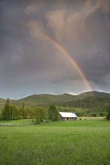 Rainbow Over A Barn In A Field. Royalty Free Stock Photography
