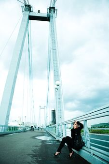 Free Lonely Girl On The Bridge Royalty Free Stock Photography - 9953877