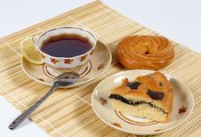 Free Tea With Lemon And Pastry. Royalty Free Stock Photography - 9953907