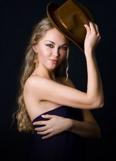 Girl With A Hat Stock Images