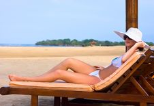 Free Brunette In White Hat On Chaise Longue Stock Photos - 9956503
